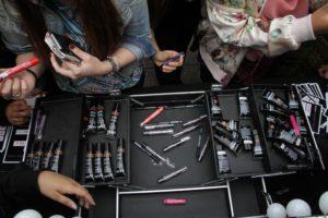 students looking through makeup